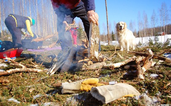 forest-trip-grandfather-making-campfire
