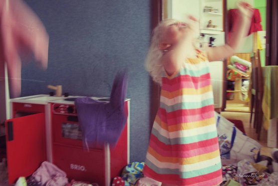 child-playing-with-clothes