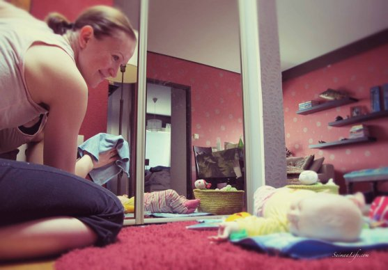Mom cleaning while baby is on the floor