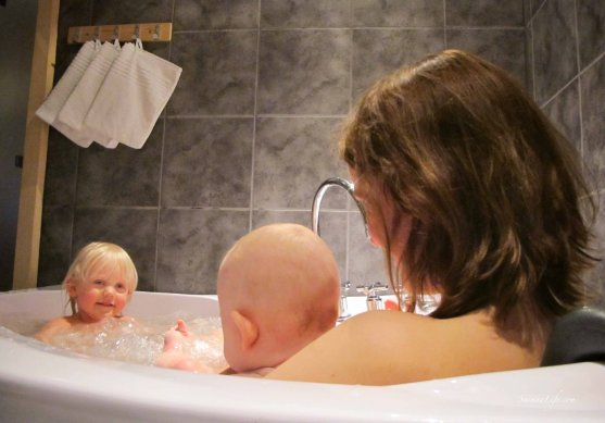 Mother and two daughters in cottage hot tub