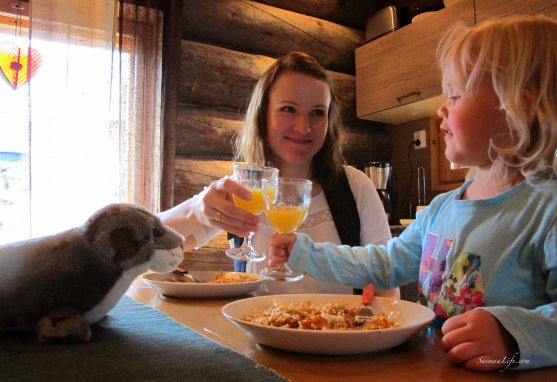 Mom and daughter eating beside cottage table