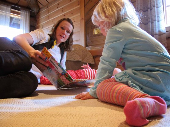 Mom and daughter playing on cottage floor