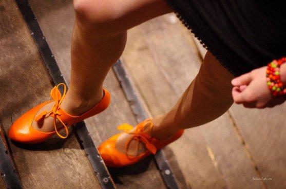 Orange Minna Parikka high heel shoes with black dress