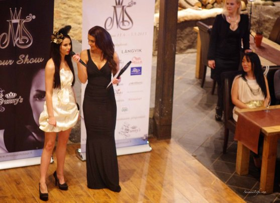 Miss Finland brunette candidate interviewed during tour show in holiday village Jarvisydan