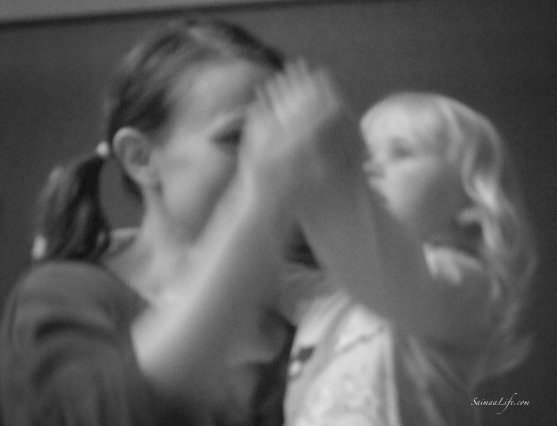 Mother and daughter dancing together black and white picture