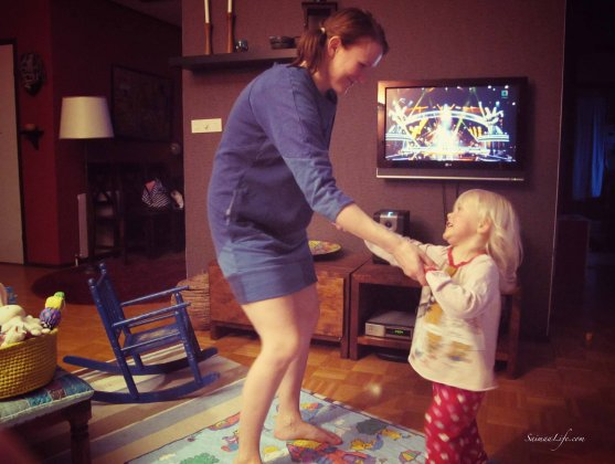 Mother and daughter dancing while voice of finland airs background