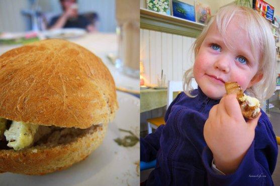 homemade herb butter bread and little girl eating