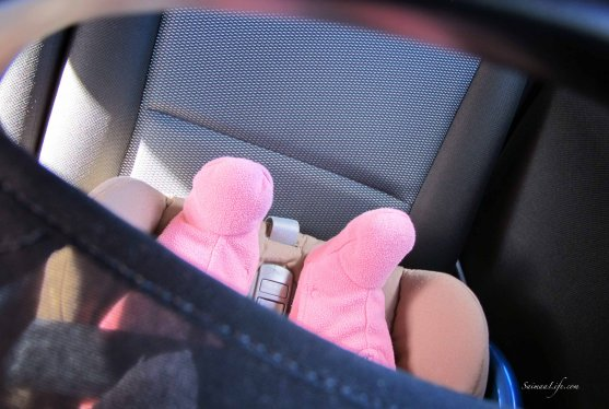 baby girl sleeping back seat only feet showing