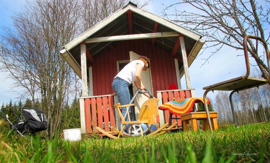 woman cleaning playhouse porch during spring