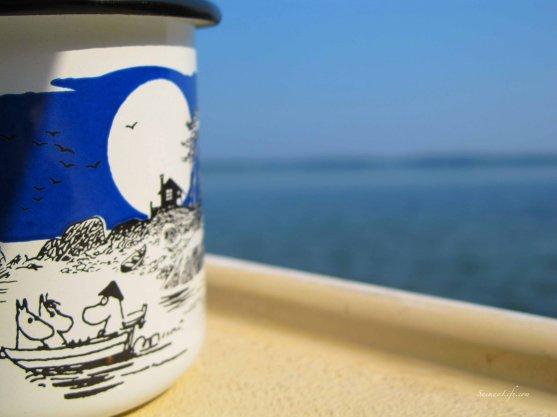 woman-having-morning-coffee-by-lake-2