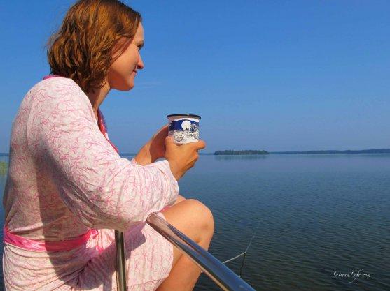 woman-having-morning-coffee-by-lake-5