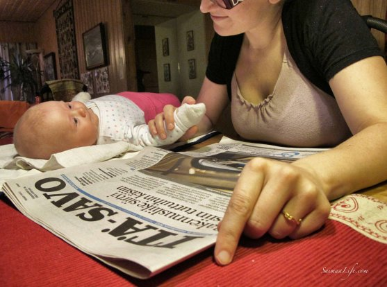 mother-baby-reading-newspaper