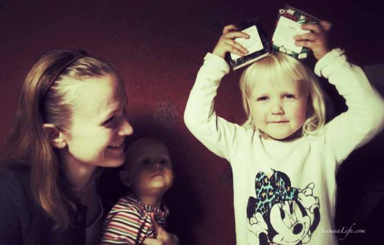 mother-and-daughters-opening-package-10