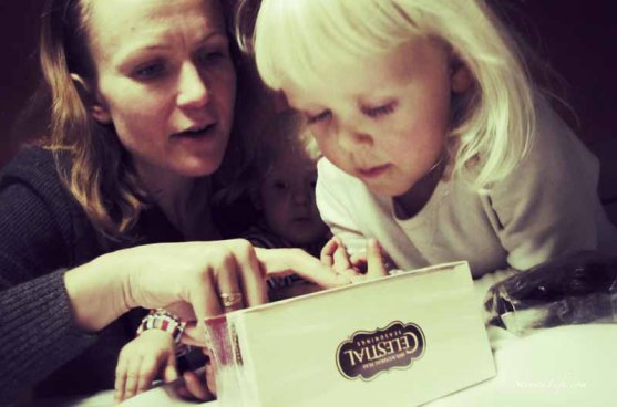 mother-and-daughters-opening-package-11