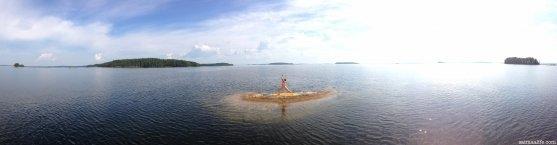 woman-practising-yoga-on-lake-puruvesi-in-savonlinna-finland