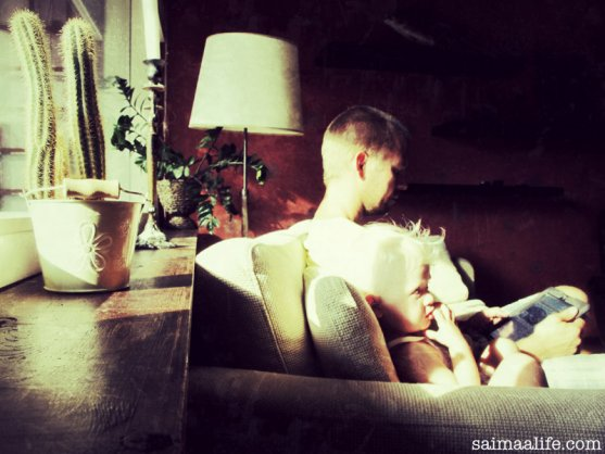 child-watching-tv-dad-using-ipad