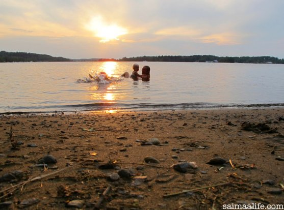 mother-and-children-swimming-on-finnish-lake