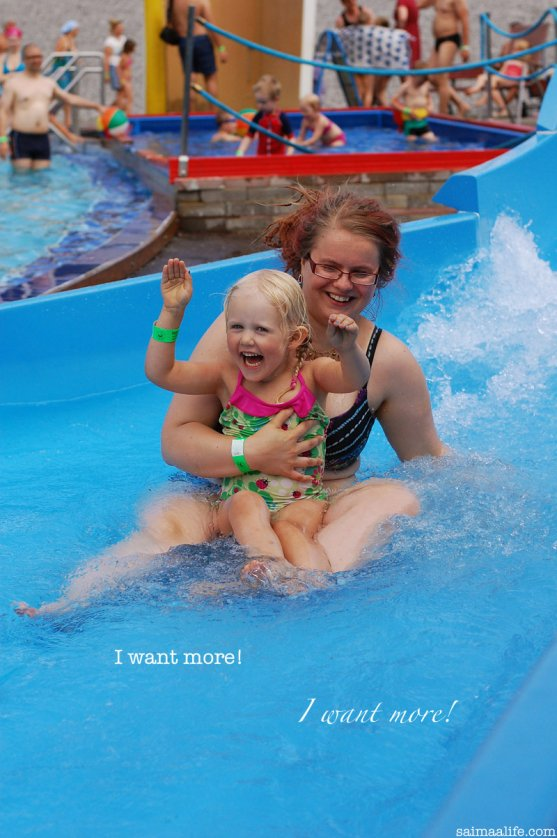 child-and-godparent-sliding-in-waterslide