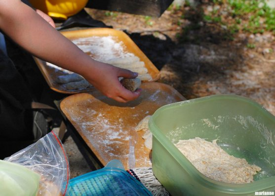 grandmother-making-campfirebread-rolls-on-island