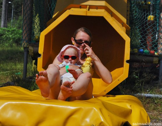 mom-and-daughter-sliding-together