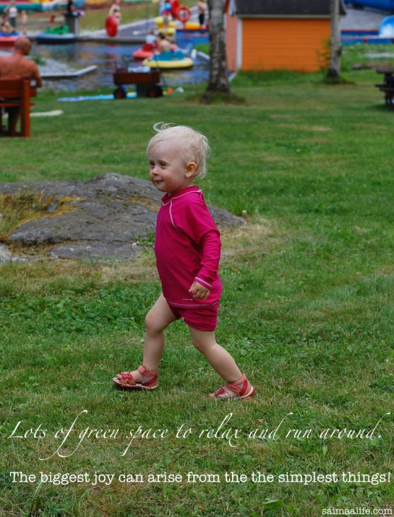 small-child-running-in-green-lawn