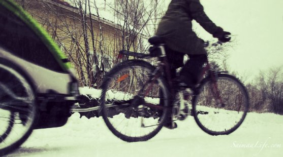 working-mother-taking-children-to-daycare-with-bicycle