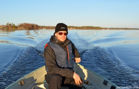 father-driving-boat-on-lake