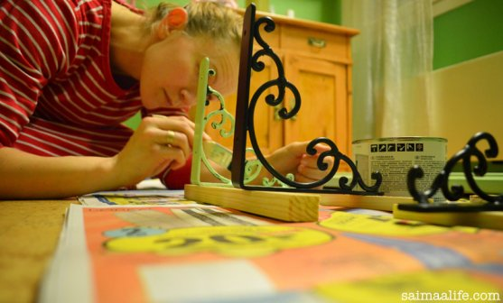 mother-paints-book-shelf-while-children-are-sleeping