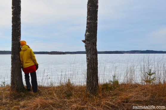 woman-by-lake-puruvesi-in-finland-in-spring