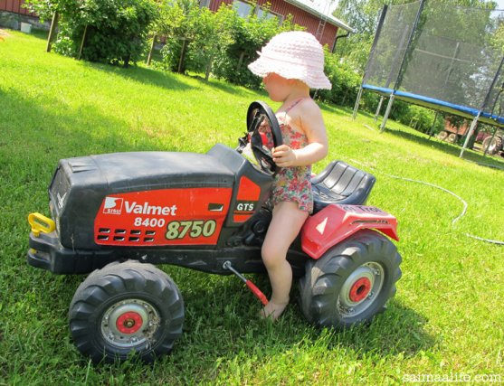 child-playing-with-childrens-tractor