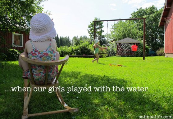 children-playing-in-garden-with-water