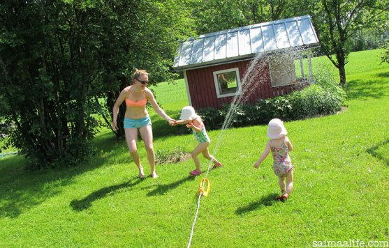mother-and-daughters-playing-together-in-garden