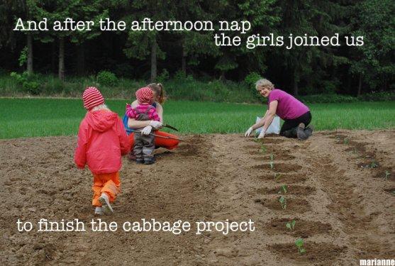 mother-grandmother-and-grandchildren-in-vegetable-garden-together