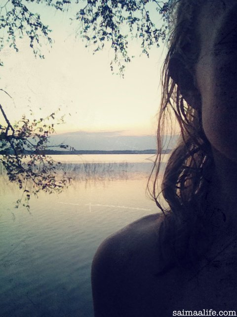 woman-after-having-lakeside-sauna