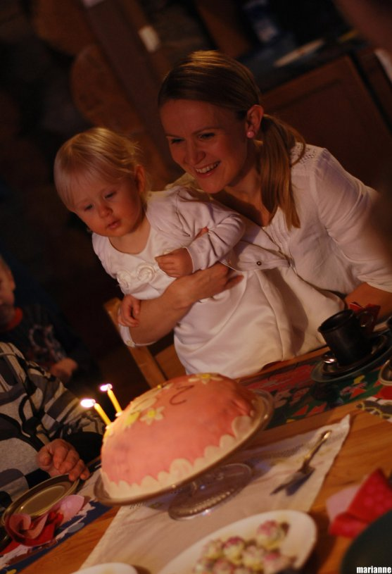 child-blowing-candles-from-birthday-cake