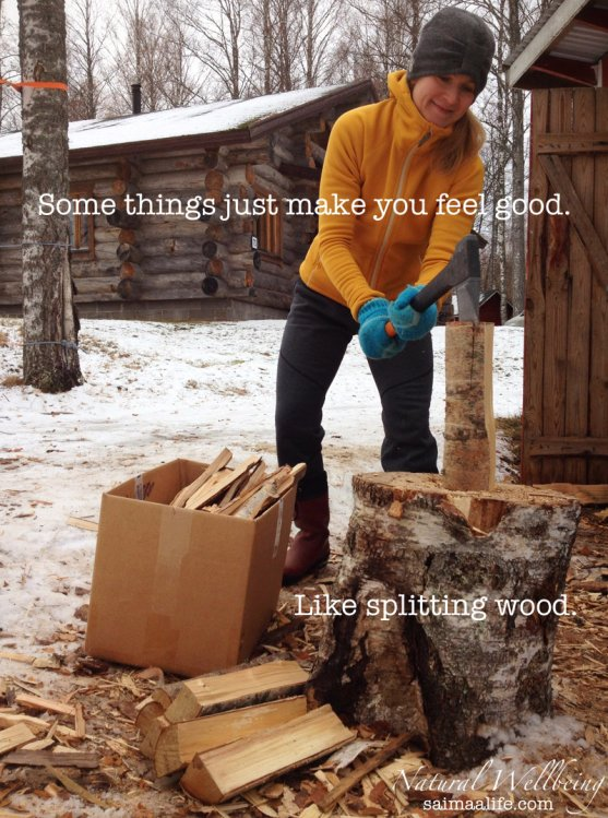 finnish-woman-splitting-wood-outdoors