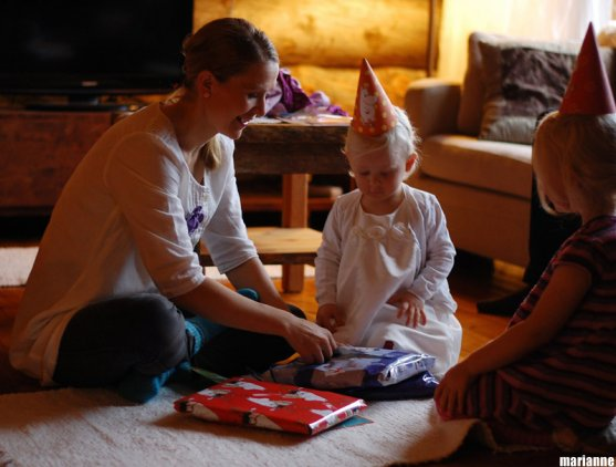 mother-and-child-opening-presents