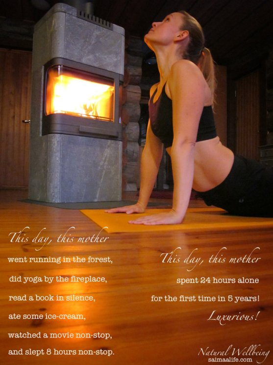 mother-practicing-yoga-by-the-fireplace-at-home