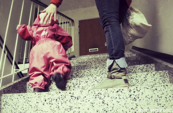 child-learning-to-go-stairs-with-her-mom