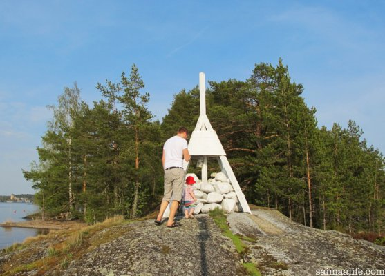 father-and-child-on-island-in-savonlinna-near-olavinlinna-castle