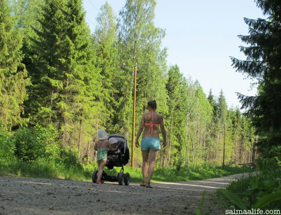 mother-and-children-walking-in-countryside