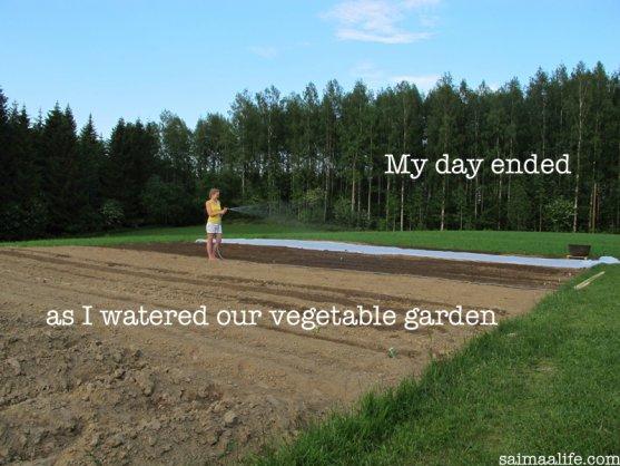 mother-watering-vegetable-garden-in-the-evening