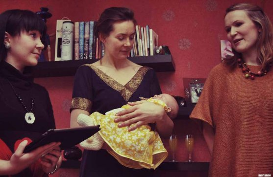 godparents reading horoscope in a naming ceremony