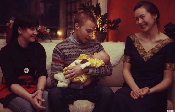 godparents gathered around a baby girl