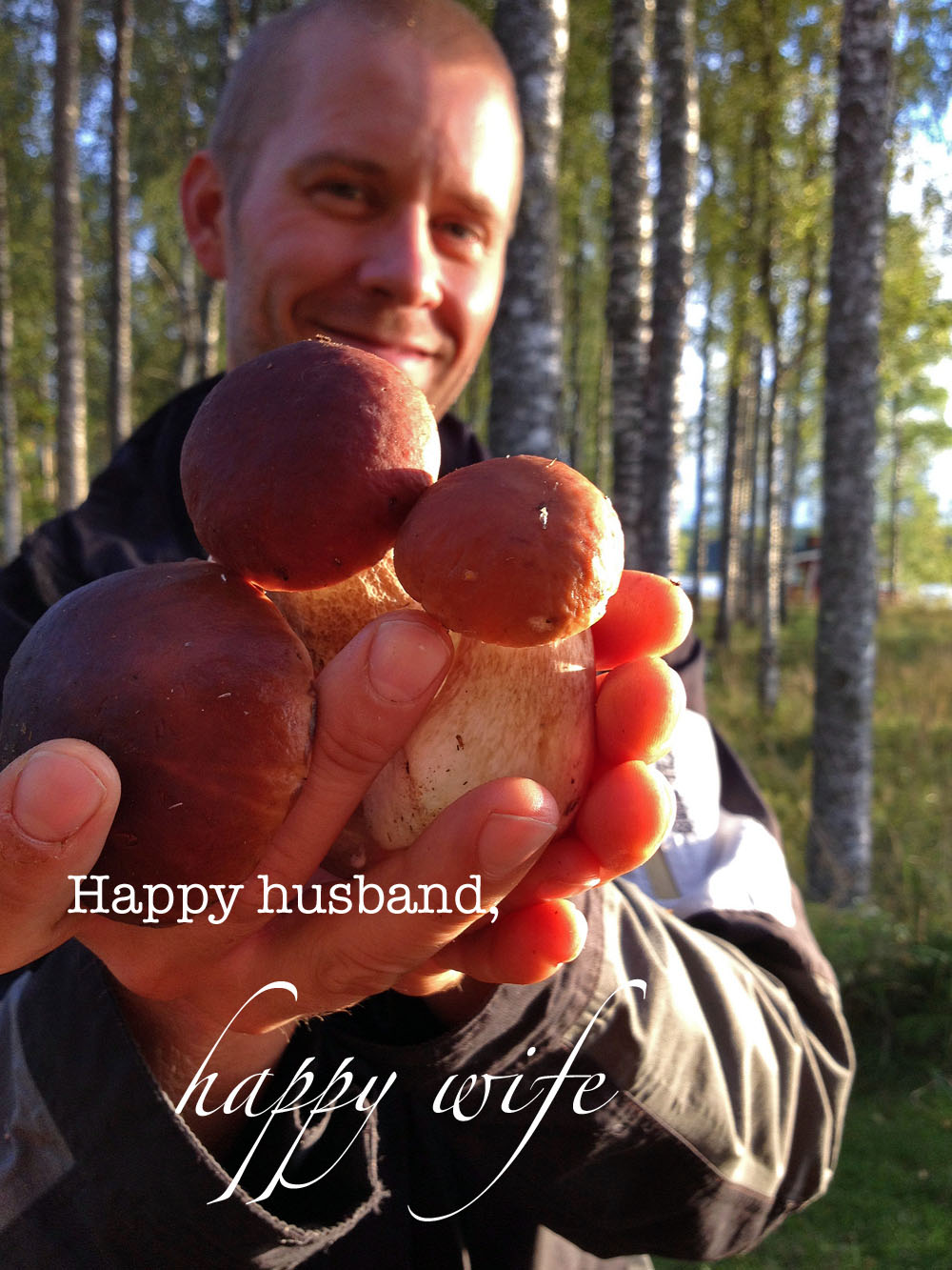 man-holding-porcini-in-his-hand