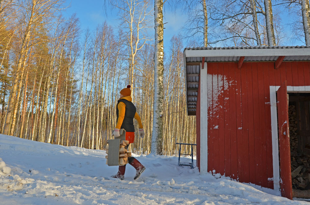 natural-rhythm-woman-carrying-firewood