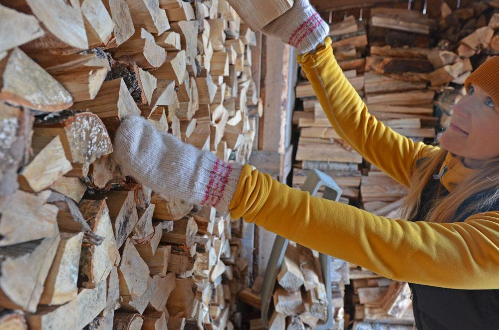 slower-rhythm-woman-taking-firewood