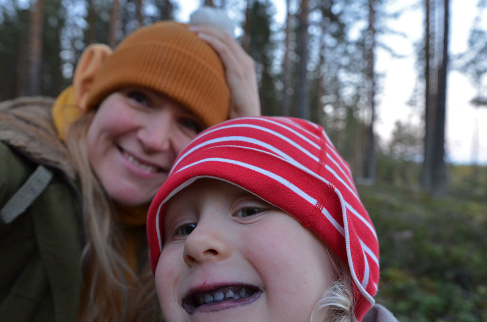 mother-and-child-eating-berries-together-in-forest