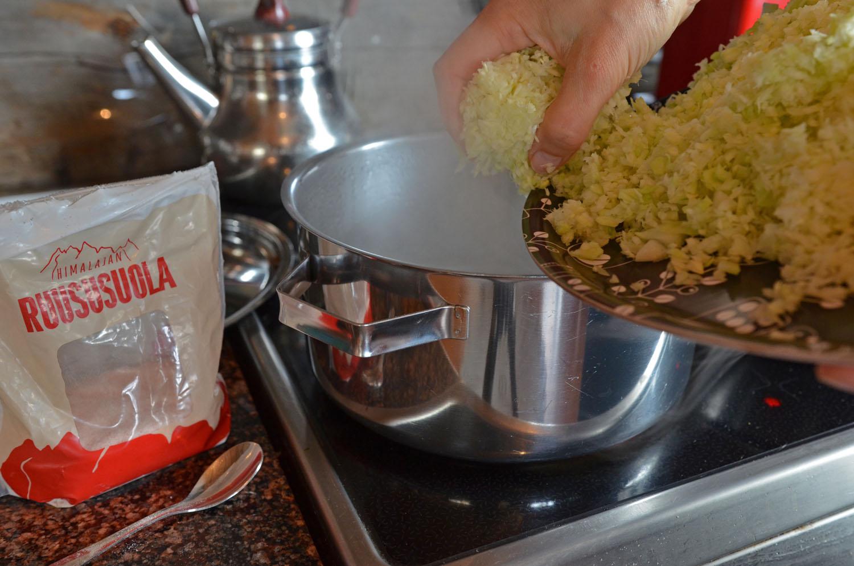 Adding white cabbage to pan