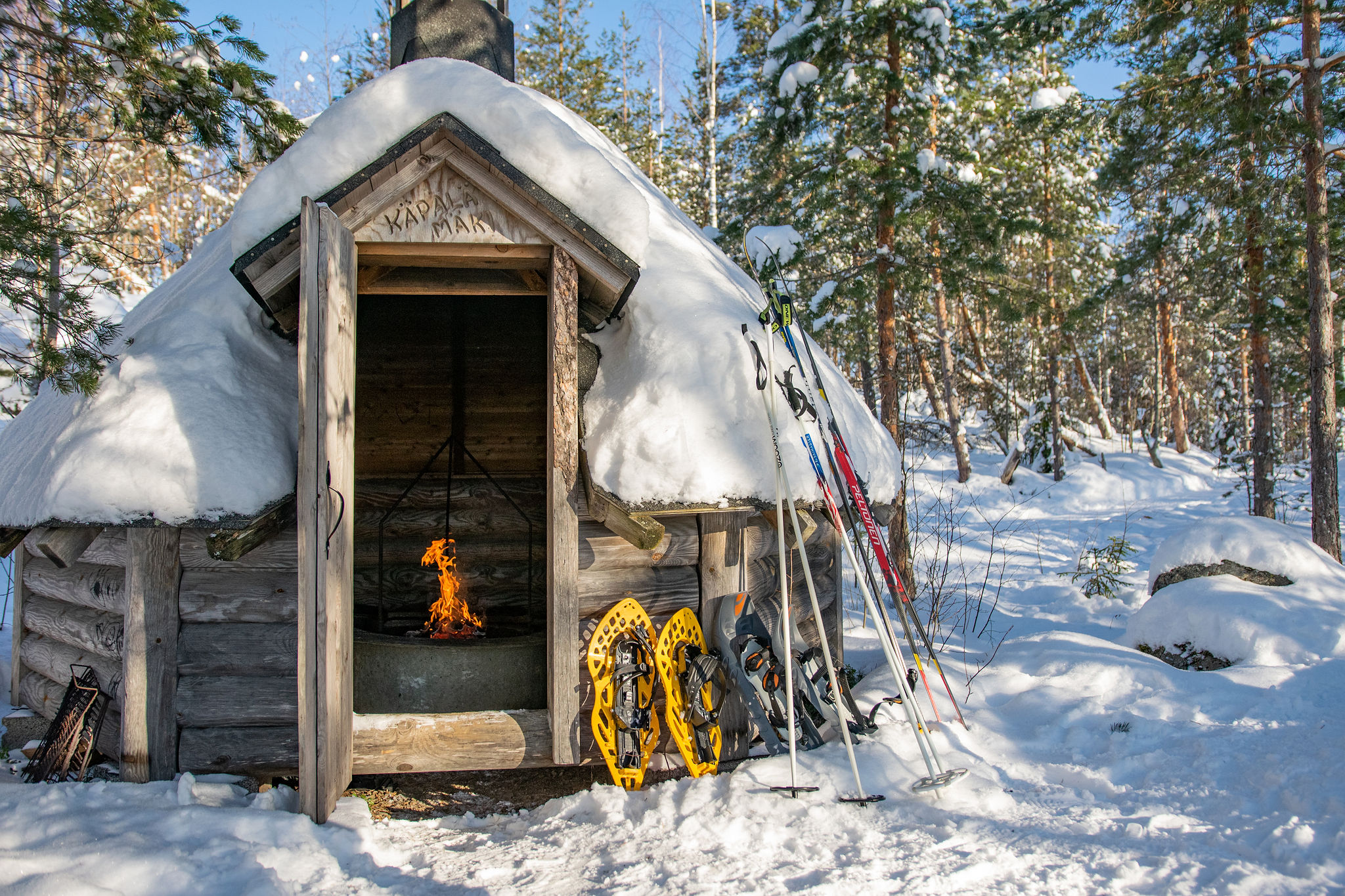 Winter campfire picnic over cross country skiing and snowshoeing